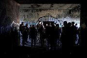 Sacred and Profane, an arts festival on Peaks Island, Maine, takes place inside the lightless remnants of a World War II fortification. Groups of artists transform the interior rooms of the enormous abandoned structure know as Battery Steele into art installations in a celebration of the full moon of the harvest season.