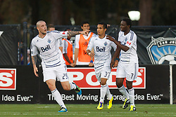 July 20, 2011; Santa Clara, CA, USA;  Vancouver Whitecaps forward Eric Hassli (29) celebrates with forward Camilo Sanvezzo (37) and midfielder Terry Dunfield (7) after scoring a goal against the San Jose Earthquakes during the first half at Buck Shaw Stadium. San Jose tied Vancouver 2-2.