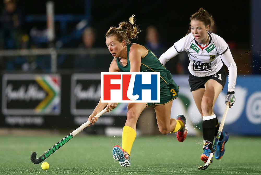 JOHANNESBURG, SOUTH AFRICA - JULY 18: Celia Evans of South Africa attempts to get away from Amelie Wortmann of Germany during the Quarter Final match between Germany and South Africa during the FIH Hockey World League - Women's Semi Finals on July 18, 2017 in Johannesburg, South Africa.  (Photo by Jan Kruger/Getty Images for FIH)