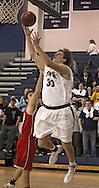 Cedar Rapids Xavier's Matt Nelson (33) puts up a shot past Ottumwa's Andrew Altfillisch (24) during their game at Xavier High School in Cedar Rapids on December 10, 2013.