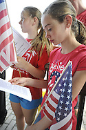 Girls dressed in red white and blue participate in the Independence Day annual reading of the Declaration of Independence on Wednesday, July 4, 2012, held by Historical Society of the Merricks, Long Island, New York, USA. Volunteers each read one line from the historic document in this Long Island tradition.