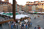 Old Town Square seen through an open window in a restaurant. Warsaw, Poland.