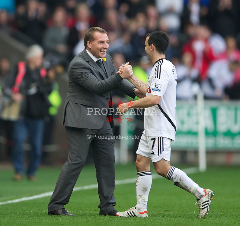SWANSEA, WALES - Sunday, March 11, 2012: Swansea City's manager Brendon Rodgers celebrates beating Manchester City 1-0 with Leon Britton during the Premiership match at the Liberty Stadium. (Pic by David Rawcliffe/Propaganda)