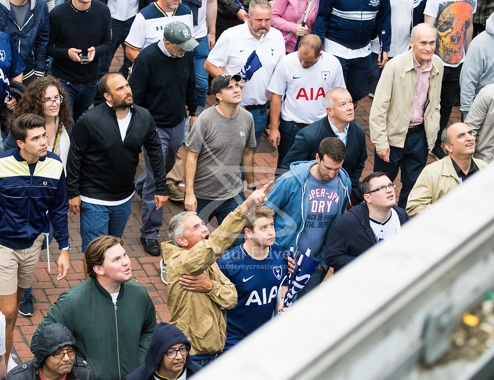 London, August 20 2017. Tottenham fans return two teenagers' abuse being shouted from the bridge approaching Wembley Park Tube station following Chelsea's 2-1 win over Tottenham Hotspur as they hosted their first game of the Premier League season at their temporary home ground, Wembley Stadium. © Paul Davey.