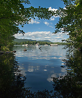 Boaters on Squam Lake, New Hampshire.  ©2013 Karen Bobotas Photographer