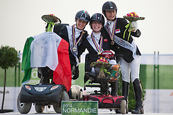 From left to right:<br /> Sara Morganti - Silver;  Sophie Christiansen - Gold;  Laurentia Yen-Yi Tan - Bronze.<br />   Podium for  Grade II Para-dressage Individual Test at the 2014 World Equestrian Games, Caen, Normandy, France..