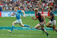 HONG KONG, HONG KONG : John Brake of England goes for the score against Hong Kong, in England's  42-7 win in the Bowl Final, at the Hong Kong Rugby Sevens, shown in Hong Kong on Sunday, 24 March, 2013.