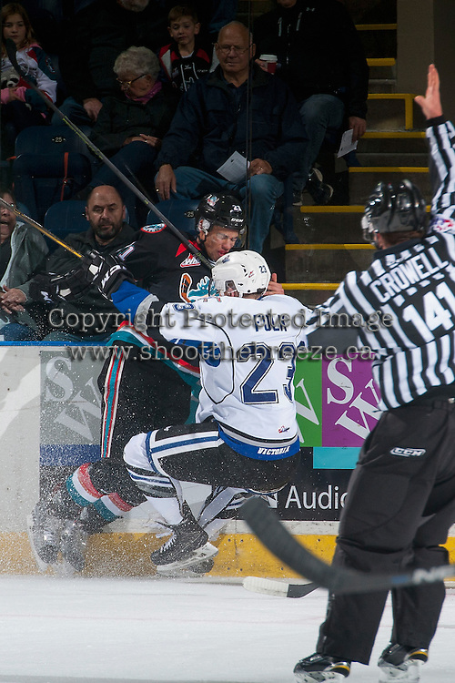 KELOWNA, CANADA - OCTOBER 26: Carter Folk #23 of the Victoria Royals checks Devante Stephens #21 of the Kelowna Rockets into the boards during first period checks  on October 26, 2016 at Prospera Place in Kelowna, British Columbia, Canada.  (Photo by Marissa Baecker/Shoot the Breeze)  *** Local Caption ***