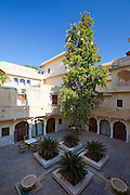 Samode Haveli luxury hotel, former merchant's house, inner courtyard in Jaipur, Rajasthan, Northern India