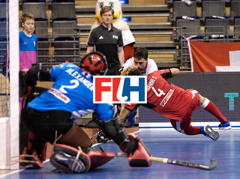 BERLIN - Indoor Hockey World Cup<br /> Men: Germany -  Trinidad &amp; Tobago<br /> foto: Tobias Hauke and de GANNES Aidan.<br /> WORLDSPORTPICS COPYRIGHT FRANK UIJLENBROEK