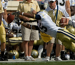 Georgia Tech wide receiver Correy Earls (15) tries to bring in a pass along the sidelines.  The Virginia Cavaliers football team faced the Georgia Tech Yellow Jackets at Scott Stadium in Charlottesville, VA on September 22, 2007.
