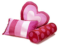 Pink pillows on white background