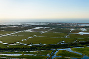 Nederland, Flevoland, Lelystad, 07-05-2018; Praamweg en spoorlijn Almere - Lelystad, zicht op Oostvaardersplassen, Oostelijk Flevoland.<br /> Eastern Flevoland.<br /> luchtfoto (toeslag op standard tarieven);<br /> aerial photo (additional fee required);<br /> copyright foto/photo Siebe Swart