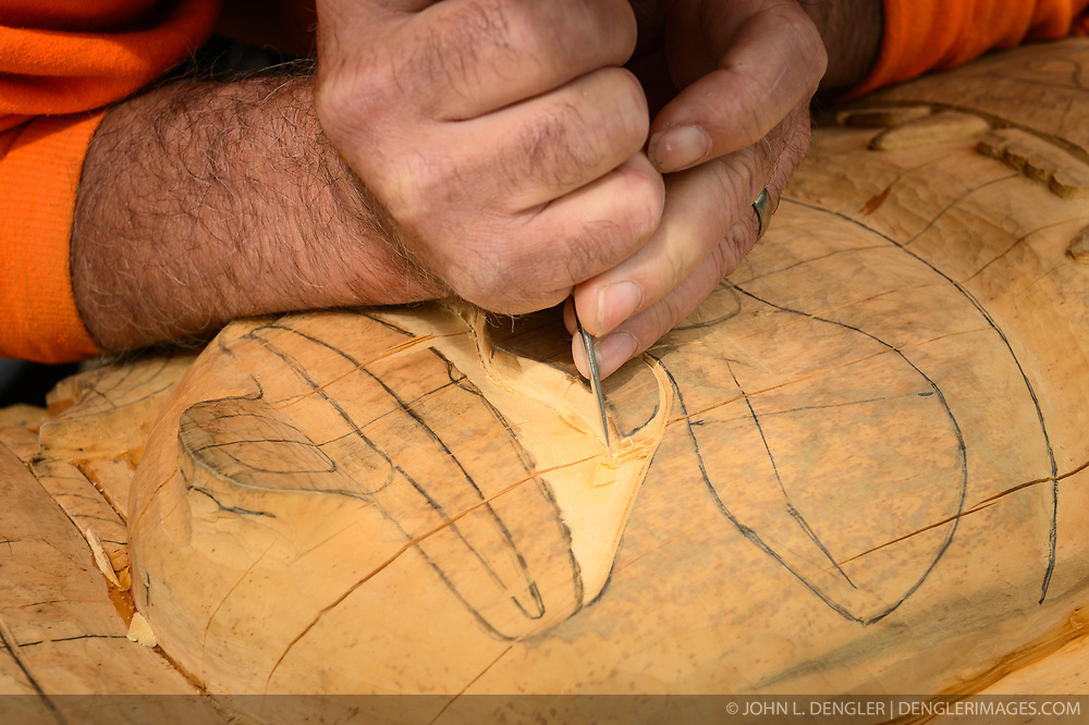 Wood carver Jim Heaton works on a totem pole carving in the Dalton City area of Haines, Alaska. Heaton specializes in Northwest Coast Art and has completed over 250 feet of totem poles. Since 2001 Jim has lead the carving projects in the Village of Klukwan and has tought Northwest Coast Art, through the University of Alaska Southeast, in Juneau, Haines and Klukwan.