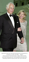 SIR EVELYN & LADY DE ROTHSCHILD at a reception in London on 10th July 2001.<br />