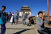 ULAN BATOR, MONGOLIA..09/05/2001.Gandan Khiid (monastery)..Wedding couple in front of Migjid Janraisig Su?m..(Photo by Heimo Aga)