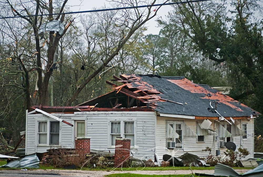 The roof is torn from a home and debris litters the trees following a tornado March 9, 2011 in Theodore, Ala. Three people were injured, and 17,000 residents were left without power following the storm. (Photo by Carmen K. Sisson/Cloudybright)