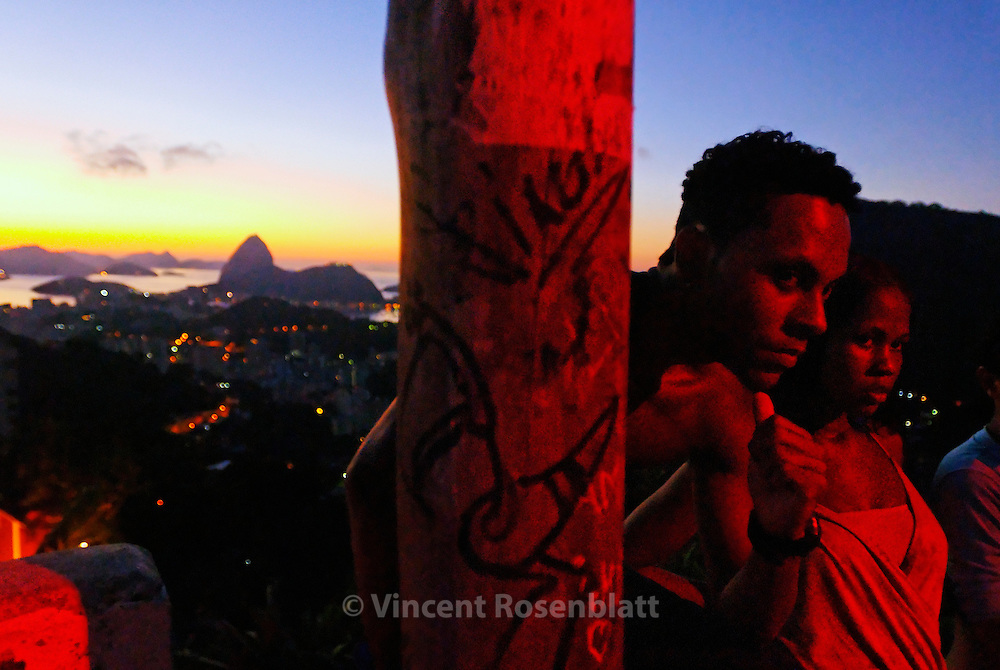 A young couple living in the favela Morro dos Prazeres, in the Santa Teresa borough. It's daybreak and the  Baile Funk is ending ... at least 500 persons have been dancing all night on the top of the hill..