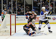 St. Louis Blues' Alex Pietrangelo (27) watches the puck shot by T.J. Oshie shoot past New York Islanders goalie Kevin Poulin (60) to score as Andrew MacDonald (47) looks on during an NHL hockey game on Saturday, Jan. 25, 2014, in Uniondale, N.Y. (AP Photo/Kathy Kmonicek)