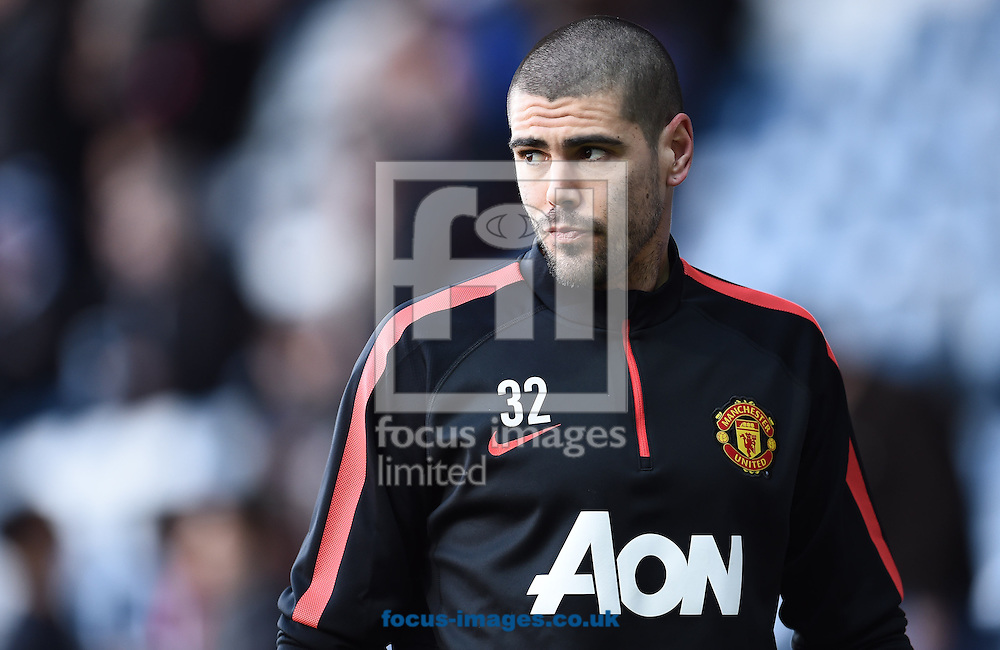 Victor Valdes of Manchester United warming up prior to the Barclays Premier League match against Queens Park Rangers at the Loftus Road Stadium, London<br /> Picture by Andrew Timms/Focus Images Ltd +44 7917 236526<br /> 17/01/2015
