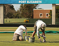 Grounds men paint the sponsors logos during the Warriors training session held at St Georges Park in Port Elizabeth on the 16 September 2010..Photo by: Shaun Roy/SPORTZPICS/CLT20