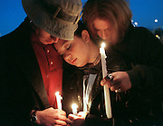 Three teens hold candles outside the Dakota County courthouse in Apple Valley, MN during a vigil in memory of a fellow teen who was shot and left paralyzed by a police officer. The incident occured during a party when the unarmed youth lunged for the officer's gun as he was responding to a noise complaint. ..