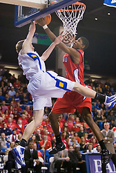 February 27, 2010; San Jose, CA, USA;  Fresno State Bulldogs guard/forward Paul George (24) blocks a dunk attempt by San Jose State Spartans guard Justin Graham (5) during the first half at The Event Center.  San Jose State defeated Fresno State 72-45.