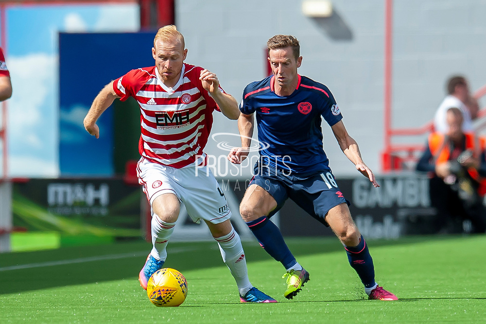 Ziggy Gordon of Hamilton Academical FC holds off Steven MacLean of Heart of Midlothian during the Ladbrokes Scottish Premiership League match between Hamilton Academical FC and Heart of Midlothian FC at New Douglas Park, Hamilton, Scotland on 4 August 2018. Picture by Malcolm Mackenzie.