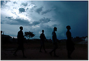 Bea Ahbeck/Fremont Argus<br /> <br /> Night commuters arrive at Charity for Peace, one of the shelters provided for night commuters in Gulu, Northern Uganda Thursday, October 27, 2005. Thousands of children make the commute every night from surrounding villages to avoid being abducted by the Lord's Resistance Army and turned into child soldiers or sex slaves. Joseph Kony's rebel army have abducted over 20,000 children in the last 18 years of war.