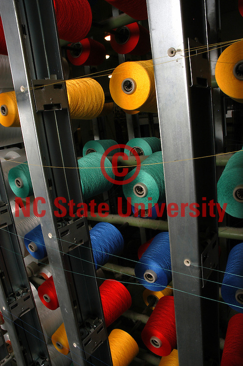 Equipment and yarn in a lab in the College of Textiles.   PHOTO BY ROGER WINSTEAD