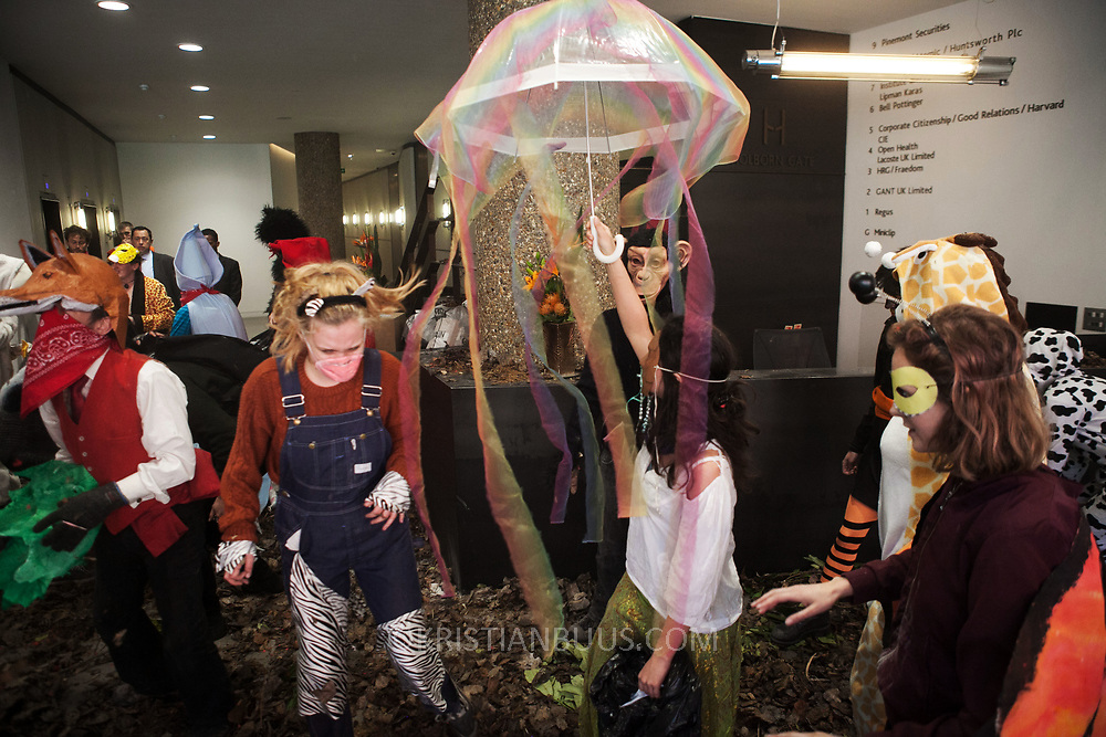 Around 40 activists dressed as animals invaded the PR firm Bell Pottinger in central London to expose their ties with fracking as part of a long running campaign against fracking by the activist group Reclaim the Power called Break the Chain.<br /> The activist spend a short while in the lobby  with zebras throwing leaves, monkeys spreading animal manure and a squid spraying &lsquo;ink&rsquo; on the windows before leaving peacefully.<br /> Bell Pottinger currently represent Centrica which is a major fracking investor in the UK according to the group's press release and the company has in the past helped the fracking company Quadrilla restore their reputation.