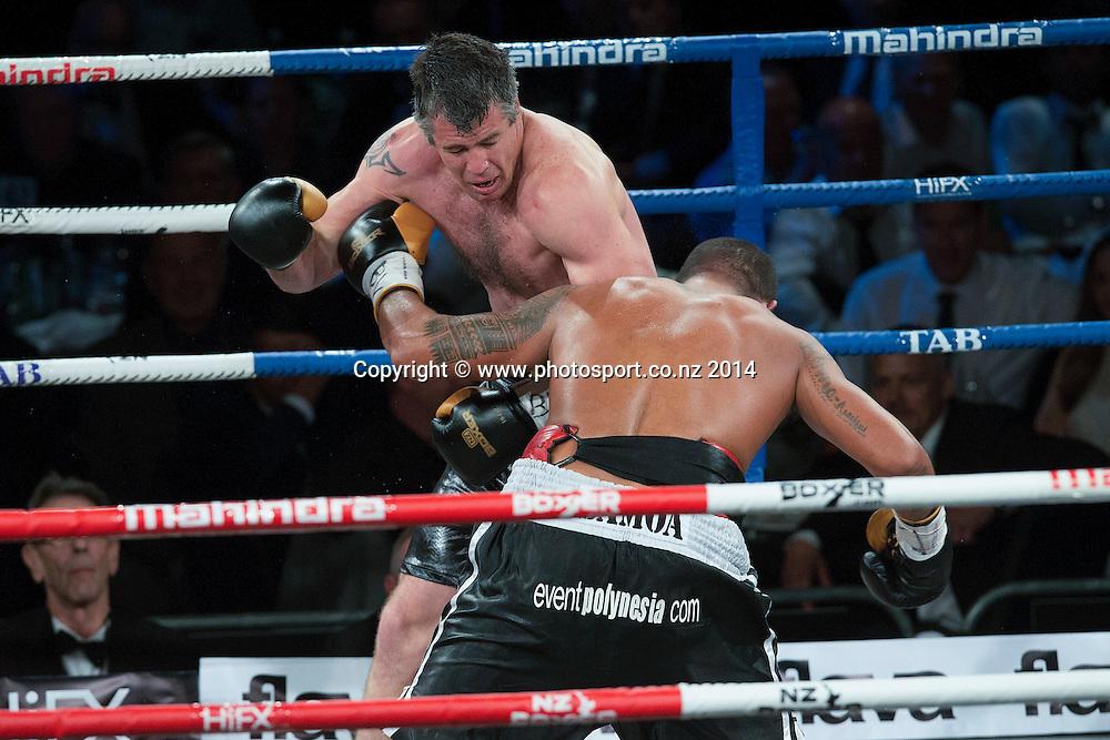 Brad `Hollywood` Pitt, (L) fights Vaitele SoI in the Mahindra Super 8 Fight Night, North Shore Events Centre, Auckland, New Zealand, Saturday, November 22, 2014. Photo: David Rowland/Photosport