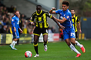 Burton Albion forward Lucas Akins and Peterborough United forward Lee Angol challenge for the ball during the The FA Cup match between Burton Albion and Peterborough United at the Pirelli Stadium, Burton upon Trent, England on 7 November 2015. Photo by Aaron Lupton.