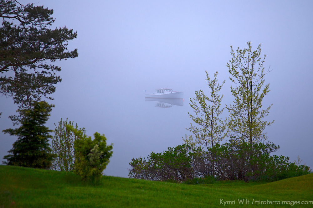 North America, Canada, Nova Scotia, Guysborough. Boat floating in fog iChedabucto Bay.