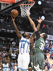 October 17, 2018 - Charlotte, NC, USA - The Charlotte Hornets' Kemba Walker (15) drives past the Milwaukee Bucks' John Henson (31) for a potential game-winning shot late in the second half at the Spectrum Center in Charlotte, N.C., on Wednesday, Oct. 17, 2018. Walker missed the shot and the Bucks won, 113-112. (Credit Image: © David T. Foster Iii/Charlotte Observer/TNS via ZUMA Wire)