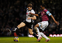 Photo: Leigh Quinnell.<br /> West Ham United v Fulham. The Barclays Premiership. 13/01/2007. Fulhams Moritz Volz holds off West Hams Nigel Reo-Coker.