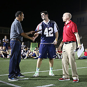 Rob Emery #42 of the Boston Cannons receives a player award following the game at Harvard Stadium on August 9, 2014 in Boston, Massachusetts. (Photo by Elan Kawesch)