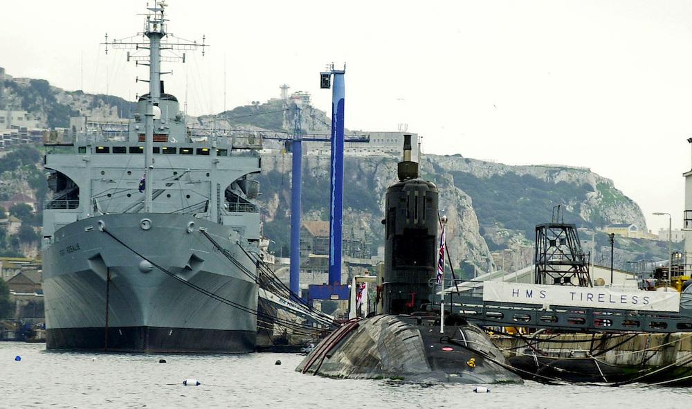 Royal Navy submarine HMS Tireless tied alongside the dockyard in Gibraltar for repairs