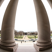 Some of the large columns on the entrance to the main building of the National Gallery of Art in Washington DC, looking across the National Mall towards the Smithsonian National Air and Space Museum on the opposite side (the black building).