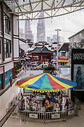 A children's carousel against the modern skyline of Shanghai, China
