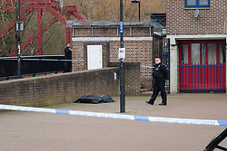 © Licensed to London News Pictures. 21/02/2017. London, UK. Police at the scene after a body was recovered from Shadwell Basin in east London today. Police were called at approximately 10:30hrs on Wednesday, 21 February to reports of a body in the water at Shadwell Basin, E1. The body, a woman believed aged in her 40s, was recovered from the water. Photo credit: Vickie Flores/LNP