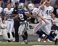 Kansas State's Justin McKinney (22) sprints past Florida Atlantic's Felix Callazo (23), as McKinney takes the opening Kick-Off for a 88-yard touchdown return at Bill Snyder Family Stadium in Manhattan, Kansas, September 9, 2006.  The Wildcats beat Florida Atlantic 45-0.