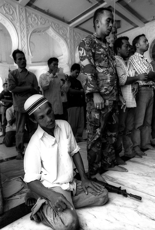Friday prayer in the Tsunami devastated city of Banda Aceh. January 7 2005.