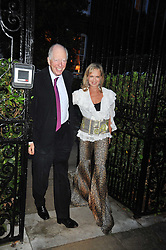 LORD ROTHSCHILD and COUNTESS MAYA VON SCHONBURG at a Summer party hosted by Lady Annabel Goldsmith at her home Ormeley Lodge, Ham, Surrey on 14th July 2009.