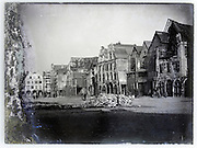 town square with buildings under construction early 1900s