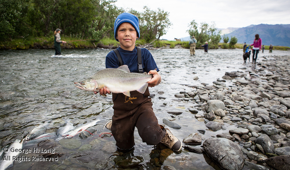Like shooting fish in a barrel, families reel in the salmon where the Six Mile Creek meets Turnagain Arm in Hope, Alaska.