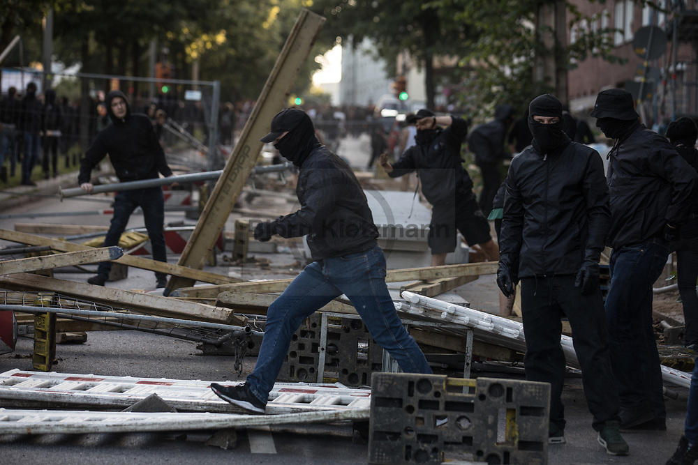 Hamburg, Germany - 06.07.2017<br /> <br /> <br /> Protestors build barricades. Radical left wing Anti-G20 protest &rdquo;Welcome to Hell&rdquo; in Hamburg. After the police stops the protests and run into it clashes took place in Hamburg.<br /> <br /> <br /> Demonstranten errichten Barrikaden. Linksradikale Anti-G20 Demonstration &rdquo;Welcome to Hell&rdquo; in Hamburg. Nachdem die Polizei die Demonstration gestoppt hat und in die Demo rannte kam es zu Ausschreitungen in Hamburg<br /> <br /> <br /> <br /> Photo: Bjoern Kietzmann