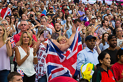 London, August 13 2017 . Fans cheer the British 4x100 team as they arrive for their gold medal ceremony on day ten of the IAAF London 2017 world Championships at the London Stadium. © Paul Davey.