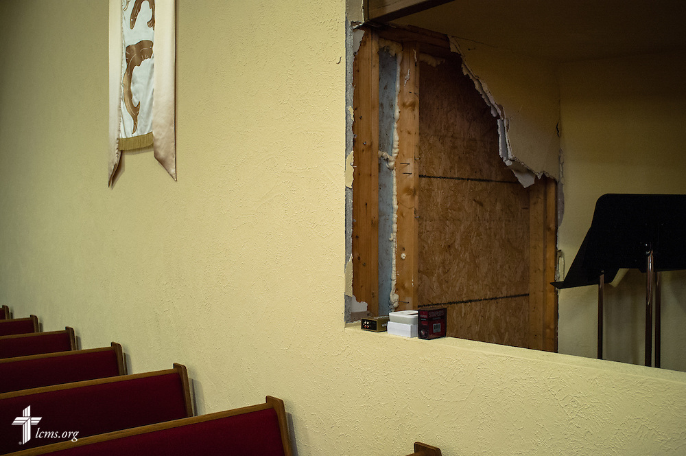 Damage is visible in the sanctuary of Our Savior Lutheran Church in Washington, Ill., on Wednesday, Dec. 18, 2013. Nearly two dozen tornadoes plowed through Illinois in November, killing a total of seven. The damaged LCMS church served as a relief center for members and nearby residents. LCMS Communications/Erik M. Lunsford