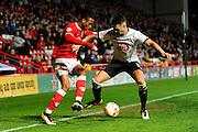 Bristol City forward Jonathan Kodjia and Derby County defender Jason Shackell during the Sky Bet Championship match between Bristol City and Derby County at Ashton Gate, Bristol, England on 19 April 2016. Photo by Graham Hunt.